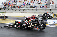Mar. 10, 2012; Gainesville, FL, USA; NHRA pro stock motorcycle rider Andrew Hines (near) races alongside Matt Smith during qualifying for the Gatornationals at Auto Plus Raceway at Gainesville. Mandatory Credit: Mark J. Rebilas-