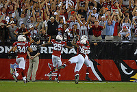 Oct. 16, 2006; Glendale, AZ, USA; Arizona Cardinals defensive tackle (90) Darnell Dockett dives into the endzone after intercepting a Chicago Bears pass at University of Phoenix Stadium in Glendale, AZ. Mandatory Credit: Mark J. Rebilas