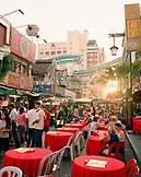 MALAYSIA, Kuala Lumpur, people eating food at street cafe in Chinatown