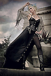 Woman in a sexy black gothic corset outfit with blue and blonde hair staring out at the stormy sky