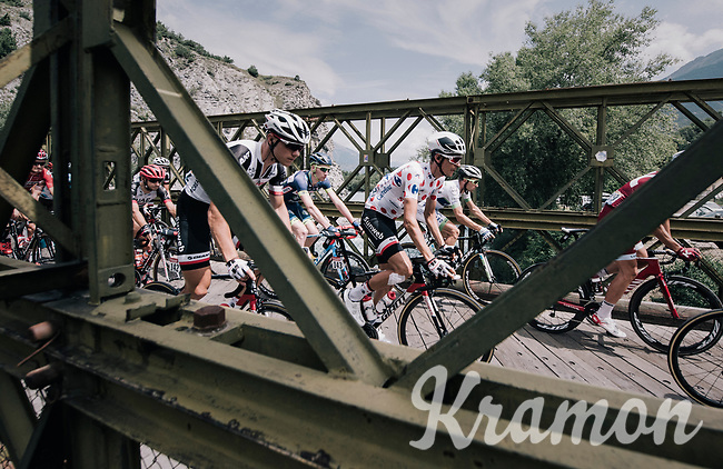 Warren Barguil (FRA/Sunweb) riding over a narrow old bridge in the neutralised section of the race<br /> <br /> 104th Tour de France 2017<br /> Stage 19 - Embrun &rsaquo; Salon-de-Provence (220km)