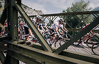 Warren Barguil (FRA/Sunweb) riding over a narrow old bridge in the neutralised section of the race<br /> <br /> 104th Tour de France 2017<br /> Stage 19 - Embrun › Salon-de-Provence (220km)