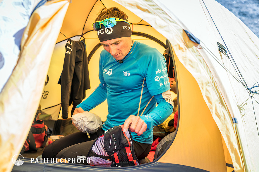 Ueli Steck inside his basecamp tent getting ready to go for a run, during the climbing expedition to the 8000 meter peak Shishapangma, Tibet