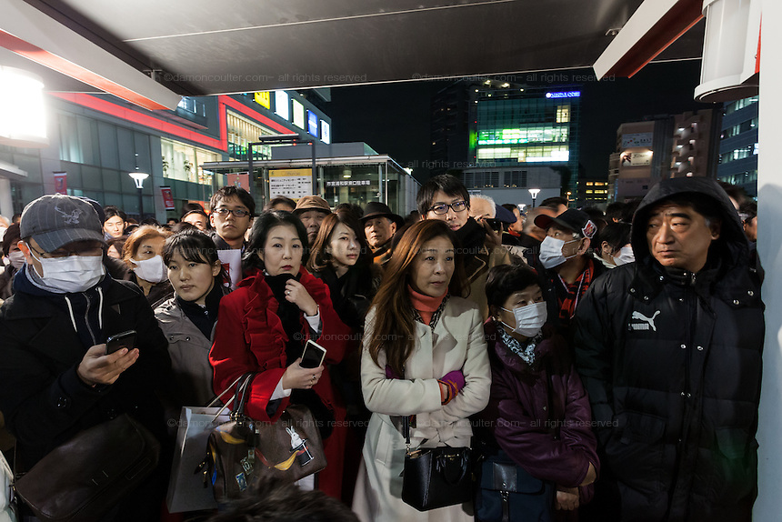 Supporters listen as Japanese Prime Minister, Shinzo Abe electioneering in Urawa, Saitama, Japan Friday December 12th 2014