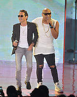MIAMI, FL - OCTOBER 29: Marc Anthony and Alexander Delgado of Gente de Zona, performs at the Jennifer Lopez Gets Loud for Hillary Clinton at GOTV Concert in Miami at Bayfront Park Amphitheatre on October 29, 2016 in Miami, Florida. Credit: MPI10 / MediaPunch