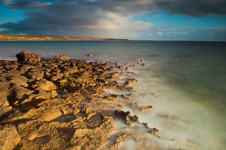 Arid coastal landscape at Shark bay salt, a solar salt farm, in Western Australia.