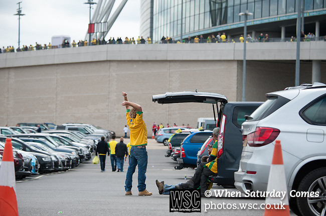 Norwich City 2 Middlesbrough 0, 25/05/2015. Wembley Stadium, Championship Play Off Final. Norwich supporters in the car park ahead of the game. A match worth £120m to the victors. On the day Norwich City secured an instant return to the Premier League with victory over Middlesbrough in front of 85,656. Photo by Simon Gill.
