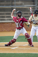Harvard Crimson catcher Josh Ellis (9) makes a throw to first base against the Wake Forest Demon Deacons at David F. Couch Ballpark on March 5, 2016 in Winston-Salem, North Carolina.  The Crimson defeated the Demon Deacons 6-3.  (Brian Westerholt/Four Seam Images)
