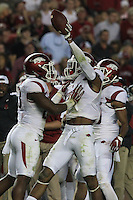 Arkansas Democrat-Gazette/BENJAMIN KRAIN --10/10/15--<br /> Arkansas defensive back Santos Ramirez (9) celebrates with Arkansas linebacker Dre Greenlaw (23) after intercepting an Alabama pass.