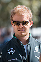 March 13, 2014: Nico Rosberg (DEU) from the Mercedes AMG Petronas F1 Team arrives at the 2014 Australian Formula One Grand Prix at Albert Park, Melbourne, Australia. Photo Sydney Low.