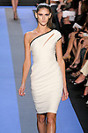 Daiane walks runway in a chalk white one shoulder jersey asymmetric draped cocktail dress with black leather trim, by Monique Lhuillier, from the Monique Lhuillier Spring 2012 collection fashion show, during Mercedes-Benz Fashion Week Spring 2012.