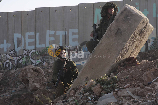 Israeli border police take position during clashes with Palestinian stone-throwers at the Kalandia checkpoint between the West Bank city of Ramallah and Jerusalem, Thursday, Oct. 8, 2009. President Barack Obama's Mideast envoy finds himself increasingly hamstrung, with Israel's foreign minister on Thursday all but ruling out a peace deal for years to come and the Palestinian leader weakened by his decision not to push for a Gaza war crimes tribunal against Israel.. Photo by Mohamar Awad