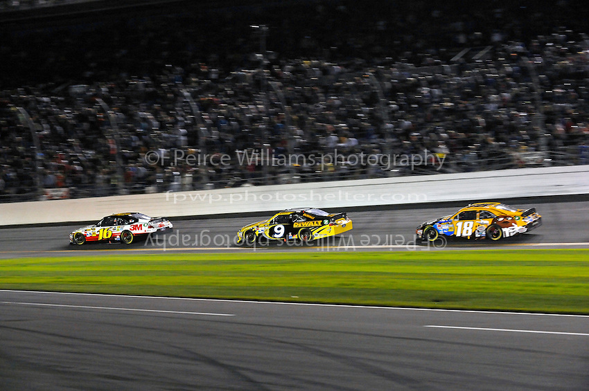 Greg Biffle (#16), Marcos Ambrose (#9) and Kyle Busch (#18).