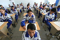 Uyghur students study Mandarin Chinese in Hetian Experimental Billingual School, in Hetian, Xinjiang province, China, on October 13, 2006. The Uyghur people are a Turkic ethnic group living mainly in the Xinjiang Uyghur Autonomous Region of China. Photo by Lucas Schifres/Pictobank