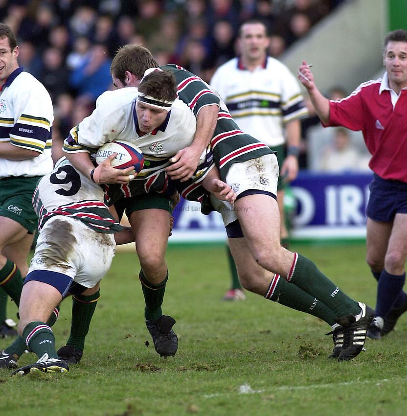 Photo. Richard Lane.London Irish v Leicester. Tetley Bitter 4th Round. 29/1/2000. .Ryan Strudwick is held by Lewis Moody and Jamie Hamilton.