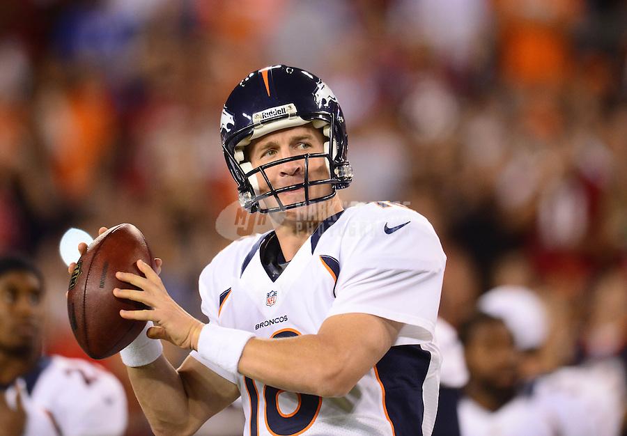 Aug. 30, 2012; Glendale, AZ, USA; Denver Broncos quarterback (18) Peyton Manning against the Arizona Cardinals during a preseason game at University of Phoenix Stadium. Mandatory Credit: Mark J. Rebilas-