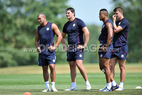 Jonathan Joseph, David Sisi, Anthony Watson and Ollie Devoto look on. Bath Rugby pre-season training session on July 16, 2013 at Farleigh House in Bath, England. Photo by: Patrick Khachfe/Onside Images