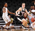 SIOUX FALLS, SD - MARCH 6:  Mikaela Shaw #22 of Omaha dribbles past defender Martha Burse #15 of IUPUI in the 2016 Summit League Tournament. (Photo by Dick Carlson/Inertia)