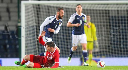 29.03.2016. Hampden Park, Glasgow, Scotland. International Football Friendly Scotland versus Denmark.  Steven Fletcher avoids the challenge of Pierre Emile Hojbjerg