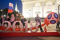 MOSCOW, RUSSIA - June 14, 2018: Russia fans pose for a photo with the logo of the World Cup at Alexander Garden, just outside Red Square, after the opening match of the 2018 FIFA World Cup between Russia and Saudi Arabia. Russia defeated Saudi Arabia 5-0.