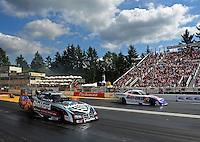 Aug. 7, 2011; Kent, WA, USA; NHRA funny car driver Matt Hagan (near lane) races against Jack Beckman during the Northwest Nationals at Pacific Raceways. Mandatory Credit: Mark J. Rebilas-