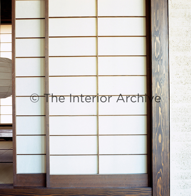 Traditional sliding shoji screens typify the Japanese-style decoration of this English loft