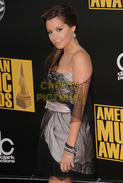 ASHLEY TISDALE .attends The 2008 American Music Awards held at Nokia Theatre L.A. Live in Los Angeles, California, USA, November 23th 2008.                                                                     .AMA AMAs AMA's half length strapless grey gray black netting mini dress  hand on hip beaded off the shoulder .CAP/DVS.©Debbie VanStory/Capital Pictures