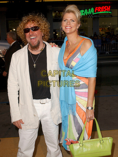 "SAMMY HAGAR & WIFE.Attends Paramount Pictures' Los Angeles Premiere of ""Sahara"" held at The Grauman's Chinese Theatre in Hollywood, Los Angeles, California, USA,.April 4th 2005..half length sunglasses peace sign gesture funny dark glasses shades.Ref: DVS.www.capitalpictures.com.sales@capitalpictures.com.©Debbie VanStory/Capital Pictures"