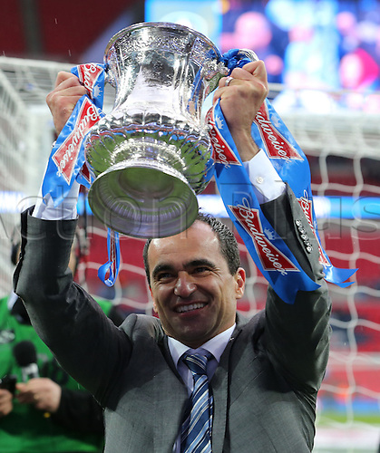 11.05.2013 London, England. Roberto Martinez manager of Wigan Athletic with Trophy after the FA Cup Final between Wigan Athletic and Manchester City from Wembley Stadium.