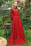 "Model poses in a raspberry corded lace bell sleeve gown with grosgrain detail from the Lela Rose Resort 2018 ""Garden Party"" collection in Jefferson Market Garden on June 7 2017, during Resort Fashion Week in New York City."