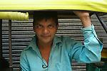 An autorickshaw driver in the Paharganj district of New Delhi, India.