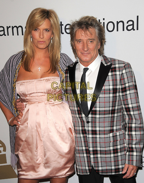 PENNY LANCASTER & ROD STEWART.The Clive Davis / Recording Academy Annual Pre- Grammy Party held at The Beverly Hilton Hotel in Beverly Hills, California, USA. .February 7th, 2009.half length pink dress silk satin purple striped stripes wrap pashmina shawl check checkered suit jacket married husband wife hand on hip plaid tartan .CAP/DVS.©Debbie VanStory/Capital Pictures.