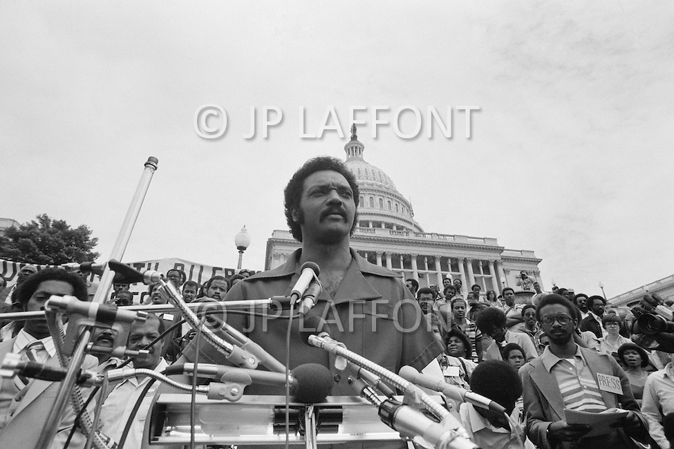 17 Mar 1980, Washington, DC, USA --- Operation PUSH (People United to Serve Humanity) was founded by African-American, Reverend Jesse Jackson (pictured), a political activist for civic rights, notably those of the black community. During the operation thousands of protesters demonstrated, in front of the White House, for employment, against the rising cost of living, and the politics of American President Jimmy Carter. --- Image by © JP Laffont