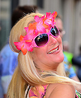 Vanessa Feltz<br /> The &quot;Bula Quo!&quot; UK film premiere, Odeon West End cinema, Leicester Square, London, England.<br /> July 1st, 2013<br /> headshot portrait pink headband flowers sunglasses shades smiling looking over shoulder <br /> CAP/BF<br /> &copy;Bob Fidgeon/Capital Pictures