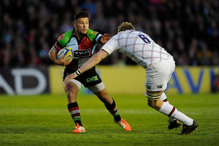Danny Care of Harlequins looks to hand off Jamie Gibson of Leicester Tigers during the Aviva Premiership match between Harlequins and Leicester Tigers at the Twickenham Stoop on Friday 18th April 2014 (Photo by Rob Munro)