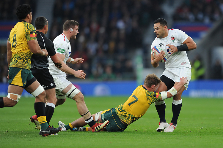 Ben Te'o of England is tackled by Michael Hooper (c) of Australia during the Quilter International match between England and Australia at Twickenham Stadium on Saturday 24th November 2018 (Photo by Rob Munro/Stewart Communications)