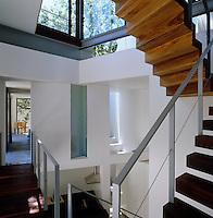 A juxtaposition of space is seen from the stairwell with views into closed-off private bedrooms and open living spaces