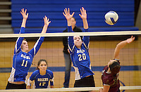 NWA Democrat-Gazette/BEN GOFF @NWABENGOFF<br /> Hannah Martin (11) and Samantha Lassiter (20) of Rogers jump to block as Madison Cooper of Siloam Springs spikes the ball on Thursday Aug. 27, 2015 during the match at Rogers High.