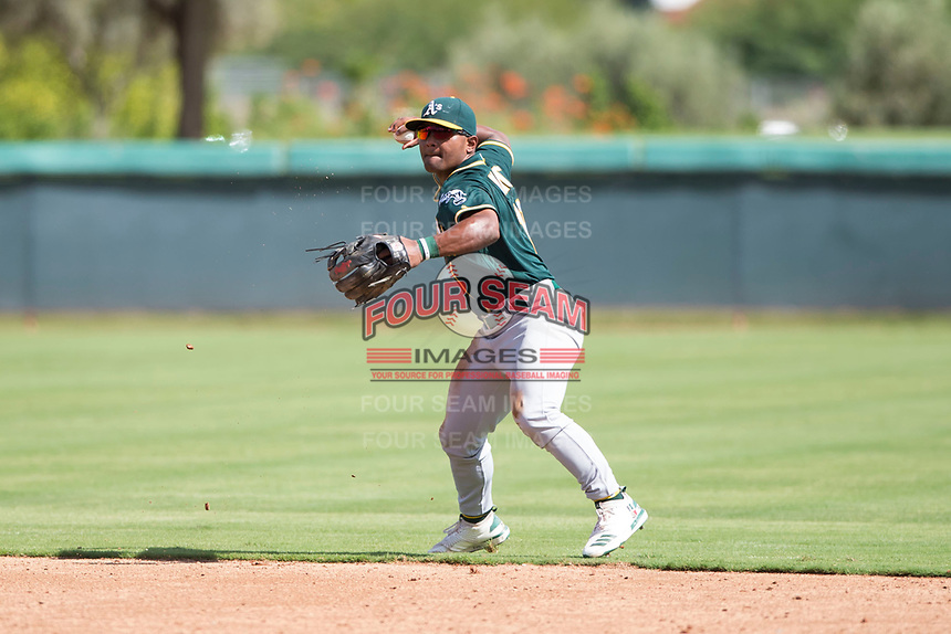 Oakland Athletics second baseman Cobie Vance (19) throws to first base during an Instructional League game against the Los Angeles Dodgers at Camelback Ranch on October 4, 2018 in Glendale, Arizona. (Zachary Lucy/Four Seam Images)