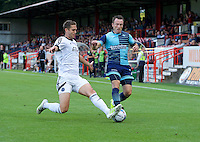 Garry Thompson of Wycombe Wanderers challenges Jack Saville of Aldershot Town for the ball during the Friendly match between Aldershot Town and Wycombe Wanderers at the EBB Stadium, Aldershot, England on 26 July 2016. Photo by Alan  Stanford.