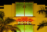 Art deco hotel with neon signage.