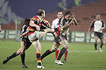 Brendon Leonard has the attention of Ben Meyer & Taiasina Tuifua during the Air NZ Cup week 5 game between Waikato & Counties Manukau played at Rugby Park, Hamilton on 26th of August 2006.