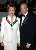 Honoree Carol Burnett , left, arrives with Brian Miller at the John F. Kennedy Center for the Performing Arts in Washington, DC on December 7, 2003, for a gala performance for the 26th national Kennedy Center Honors.  The Kennedy Center Honorees are being acknowledged for their unique contributions to the cultural life of the nation. .Credit: Ron Sachs / CNP