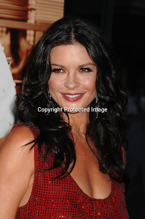 """Catherine Zeta-Jones in Emmanuel Ungaro red Dress..posing for photographers at The New York Premiere of ..""""No Reservations"""" starring Catherine Zeta-Jones and Aaron Eckhart on July 25, 2007 at The Ziegfeld Theatre in New York. ..Robin Platzer, Twin Images....212-935-0770"""