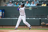 Cleuluis Rondon (5) of the Winston-Salem Dash follows through on his swing against the Myrtle Beach Pelicans at BB&T Ballpark on April 18, 2015 in Winston-Salem, North Carolina.  The Pelicans defeated the Dash 4-1 in game one of a double-header.  (Brian Westerholt/Four Seam Images)