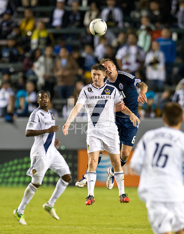 CARSON, CA - November 1, 2012: LA Galaxy forward Robbie Keane (7) and Vancouver defender Jay DeMerit (6) during the LA Galaxy vs the Vancouver Whitecaps FC at the Home Depot Center in Carson, California. Final score LA Galaxy 2, Vancouver Whitecaps FC 1.