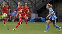 Portland, Oregon - Saturday July 2, 2016: Portland Thorns FC midfielder Celeste Boureille (30) passes the ball during a regular season National Women's Soccer League (NWSL) match at Providence Park.