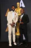 Barry Jenkins &amp; Tarell Alvin McCraney in the photo room at the 89th Annual Academy Awards at Dolby Theatre, Los Angeles, USA 26 February  2017<br /> Picture: Paul Smith/Featureflash/SilverHub 0208 004 5359 sales@silverhubmedia.com