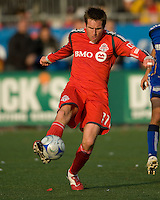 26 April 2009: Toronto FC midfielder Jim Brennan #11 kicks the ball up field during an MLS game at BMO Field between Kansas City Wizards and Toronto FC.Toronto FC won 1-0. .