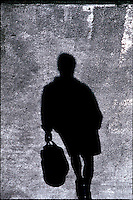Overview of the shadow of a walking person.